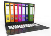 File in database. laptop with colored ring binders — Stock Photo