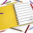 Stock Photo: 3d white person with blank spiral notepad and pencil colors.