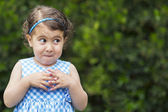 Mischievous girl expression — Stock Photo