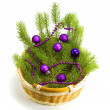 Toys with a fur-tree in a basket — Stock Photo