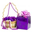 Gift and toys in a basket on a white background — Stock Photo