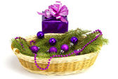 New Year's gift with a fur-tree in a basket — Stock Photo