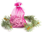 Bag with pearls and a fur-tree — Stock Photo