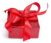 Red gift tied up by a bow — Stock Photo