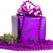 Violet gift with an ornament and a fur-tree — Stock Photo #19076823