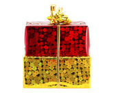Red and yellow gift on a white background — Stock Photo