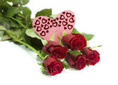 Bouquet of roses and card heart — Stock Photo