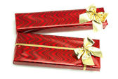 Red gifts with gold bows — Stock Photo