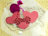 Hearts, pebbles, woven cloth on wood — Stock Photo