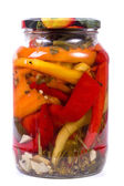 Pickled peppers and spices in a bank — Stock Photo