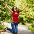Happy girl jumping outdoors — Stockfoto