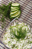 Salad from cabbage with a cucumber and greens — Stock Photo