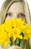The girl with a narcissus — Stock Photo