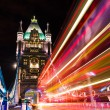 Tower Bridge in London, UK with moving red double-decker bus — Stock Photo
