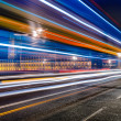 Stock Photo: Long exposure of a bus in front of the Big Ben in London, UK