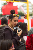 Young Woman with Camera at Wong Parade in Lima, Peru — Stock Photo
