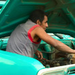 Man in Engine Bay of a Car in Silvia, Colombia — Stock Photo #45801199