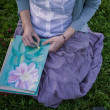 Girl draws flowers with pastels — Stock Photo