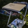 Folding stool and drawing on the grass — Stock Photo