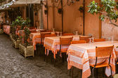 Vintage outdoor restaurant in Italy — Stock Photo