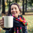 Girl in an autumn part with a white cup of hot drink — ストック写真