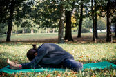 Woman doing yoga in park — Stock Photo