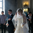 Bride and groom during orthodox wedding ceremony - Stock Photo
