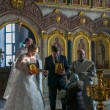 Bride and groom during orthodox wedding ceremony - Photo