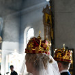 Bride and groom during orthodox wedding ceremony - Lizenzfreies Foto