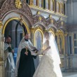 Bride during orthodox wedding ceremony - Stok fotoğraf