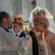 Bride and groom during orthodox wedding ceremony - ストック写真
