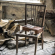 Old chair in abandoned room — Stock Photo
