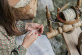 Hands of a woman   traditional wool spinning. — Стоковое фото