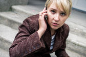 Blonde girl with mobile phone  — Stock Photo