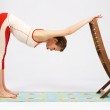 Lovely sporty woman doing stretching exercise — Stock Photo #11307650