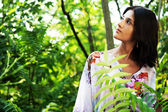 Gorgeous woman in tropical forest — Stock Photo