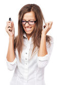 Infuriated woman with cellphone — Stock Photo