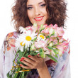 Beautiful happy woman with bouquet of flowers — Stock Photo #27042391