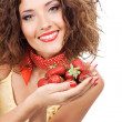 Lovely woman with handful of strawberry — Stock Photo
