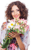 Beautiful happy woman with bouquet of flowers — Stock Photo