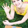 Young cheerful woman having rest in the park with laptop  — Stock Photo