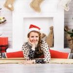 Girl doing yoga on Christmas — Stock Photo #38721843