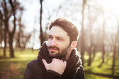 Handsome man in a forest — Stock Photo