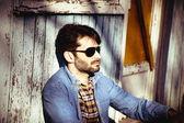 Young stylish man in denim clothing  — Stock Photo