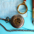 Antique pocket watch with a magnifying glass and an old pen — Stock Photo #16896115