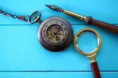 Antique pocket watch with a magnifying glass and an old pen — Stock Photo
