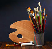 Palette with paintbrushes — Stock Photo