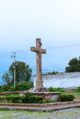Cross in front of Oxtotipac church and monastery, Mexico. — Stock Photo