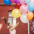Royalty-Free Stock Photo: Woman with balloons
