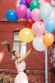 Kobieta z balonów — Zdjęcie stockowe